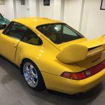 yellow porche carrera RS back