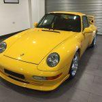 yellow porche carrera RS front